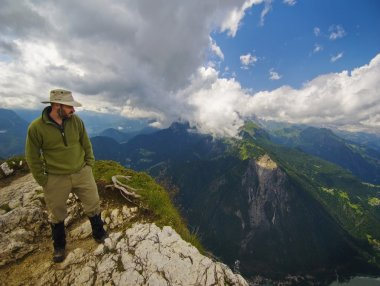 Man Standing At The Edge Of A Mountain Looking Over. Veneto, Italy
