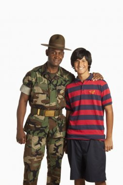 Military man embraced a teenage boy
