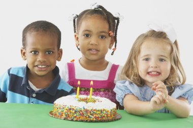 Three Children With A Birthday Cake