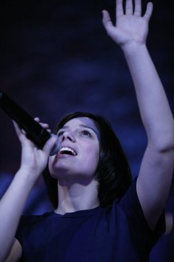 Woman Raising Hand In Worship