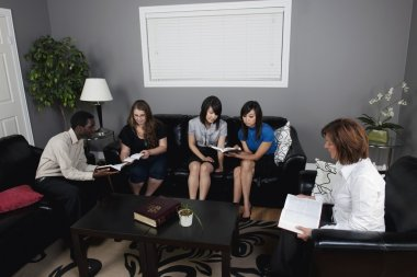 Group Of People Talking In A Living Room