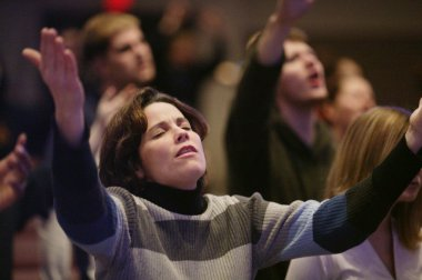 Woman Raising Hands In Worship