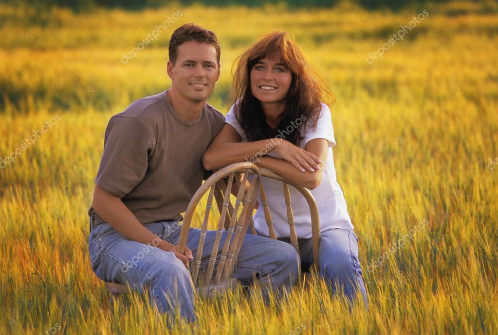 Couple In Autumn Field