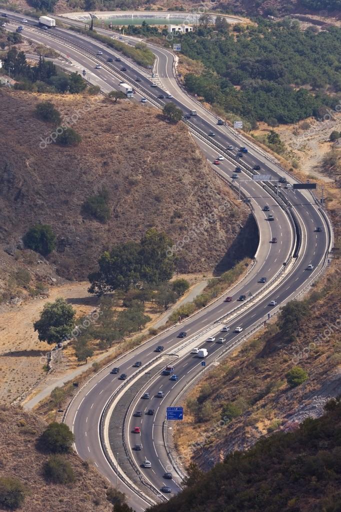 Highway Winding Through Landscape
