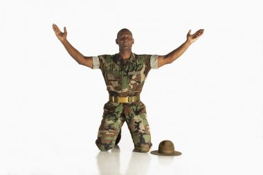 Military Man With Arms Raised And Eyes Closed