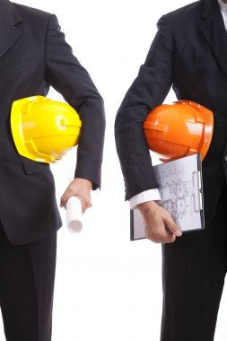 Construction engineers with helmets and documents