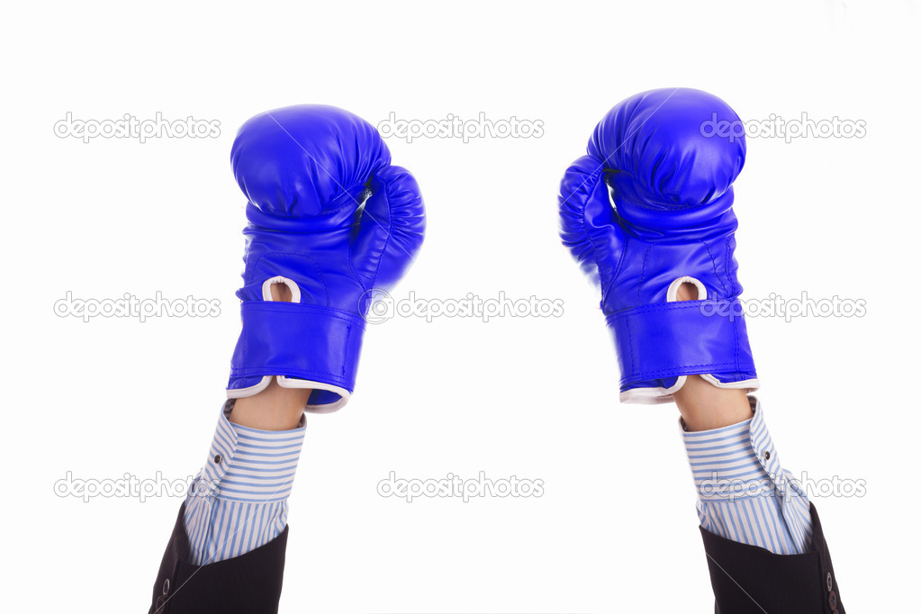 Businessman in blue boxing gloves raised his hands up