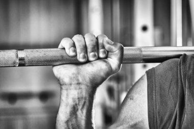 Sportsman's hand pushing barbell