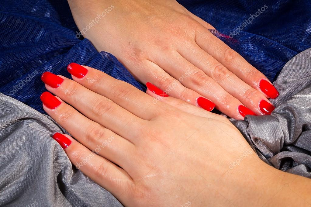 Beautiful Female Hands With Red Nail Polish On The Nails A Gray Blue Background Photo By Aallm