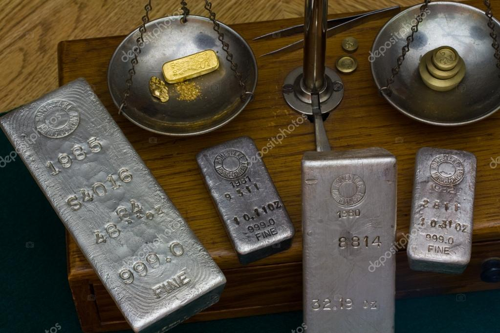Silver Bars on Antique Balance Scale