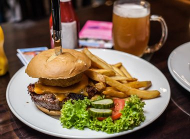 Burger with salad and beer