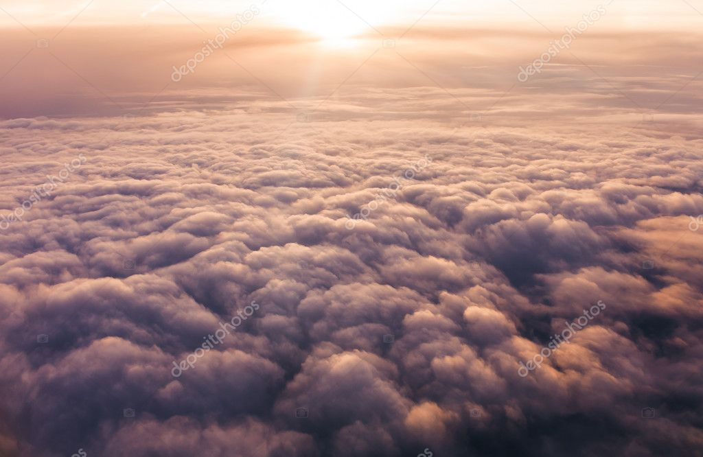 Clouds at sunset from plane window