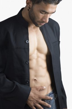 Man checking his abdominal muscles