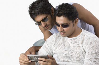 Two friends text messaging