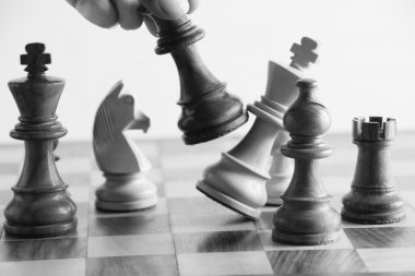 Hand defeating a king in the game of chess