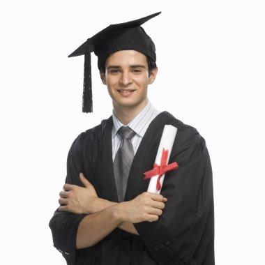 Graduate holding his diploma