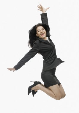 Businesswoman jumping with joy