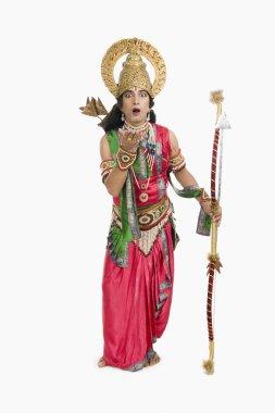 Artist dressed-up as Rama the Hindu