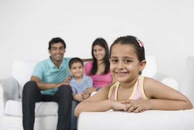Girl smiling with her family