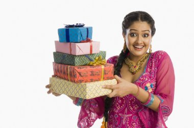 Woman in traditional dress holding gifts