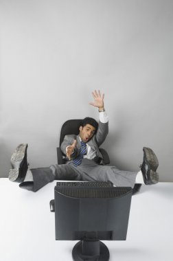 Businessman with his feet up