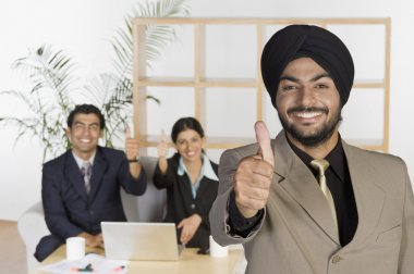 Businessman showing thumbs up sign
