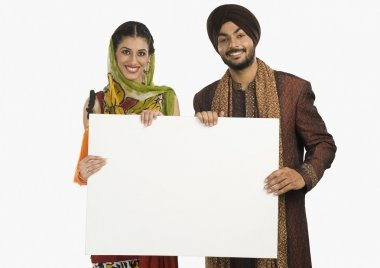 Portrait of a Sikh couple holding a blank placard stock vector