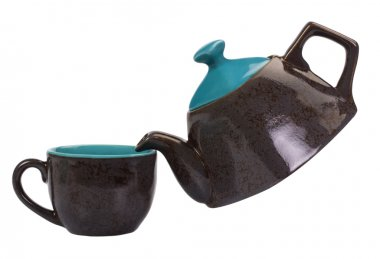 Close-up of a tea kettle with a tea cup