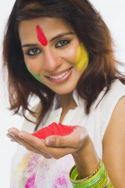 Woman holding Holi colors