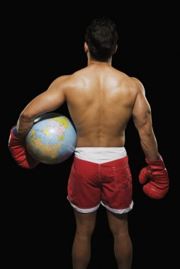Male boxer holding a globe