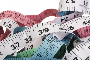 Close-up of tangled tape measures