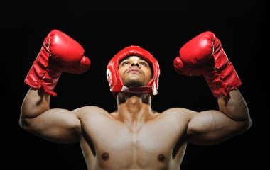 Male boxer with arms over his head