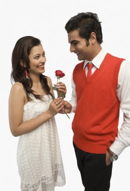 Man giving a rose to his girlfriend