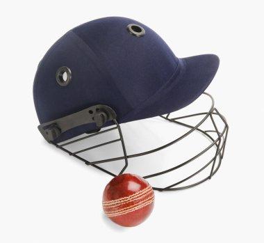 Cricket ball and a helmet
