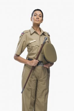 Female police officer holding a stick
