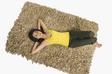Woman lying on a rug