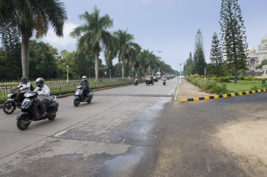 Traffic with government building on roadside