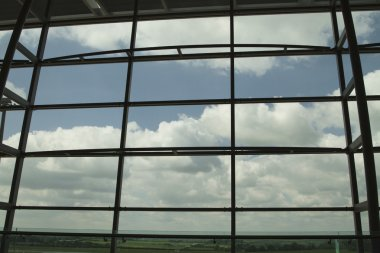 Clouds viewed through an airport lounge window