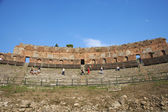 Photo Tourists at ancient Greek theatre