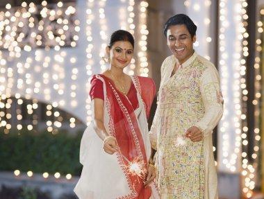 Bengali couple burning firecrackers