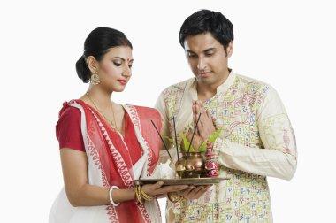 Bengali couple praying