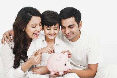 Family with a piggy bank