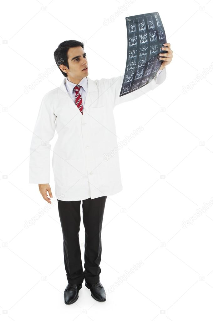 Male doctor examining an MRI report