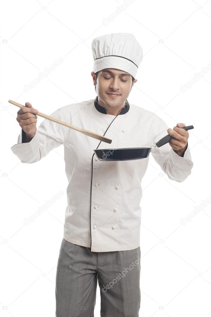 Chef preparing food in a frying pan