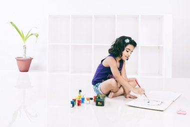 Girl painting with water colors