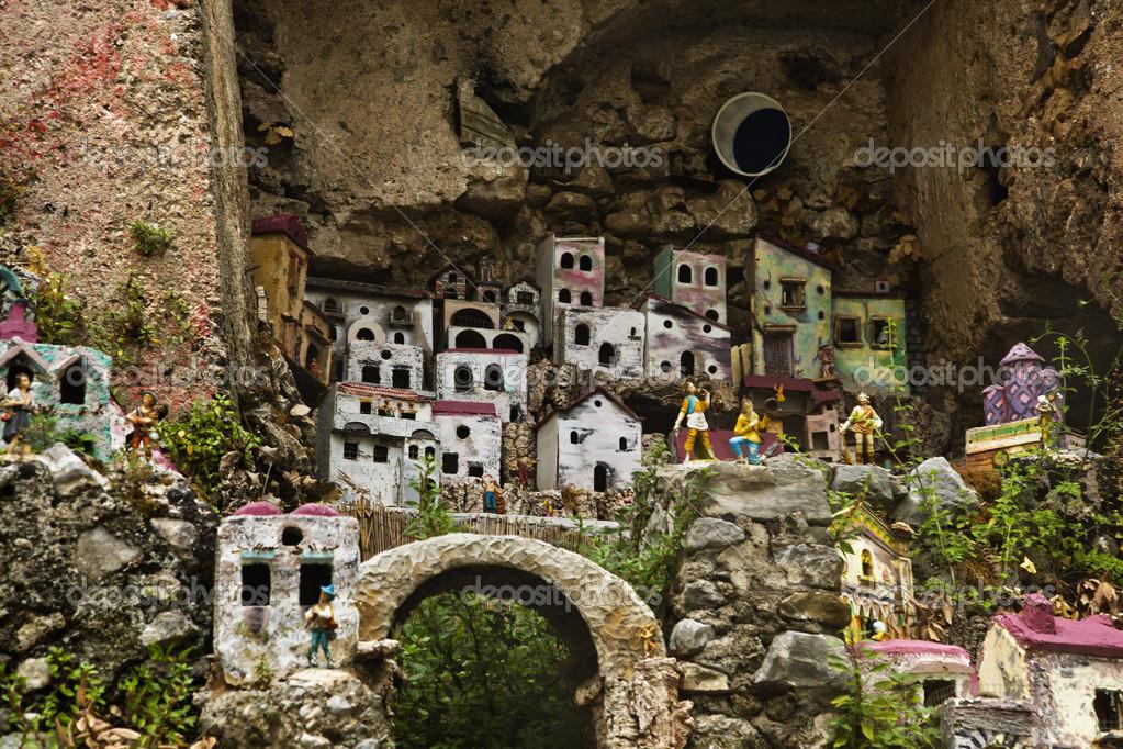 Miniature houses on the rocks