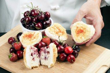 Chef Displays Strawberry Cherry Muffin