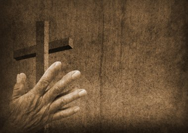 Praying hands with cross
