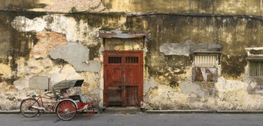 Old Red Door and Trishaw in George Town, Penang, Malaysia