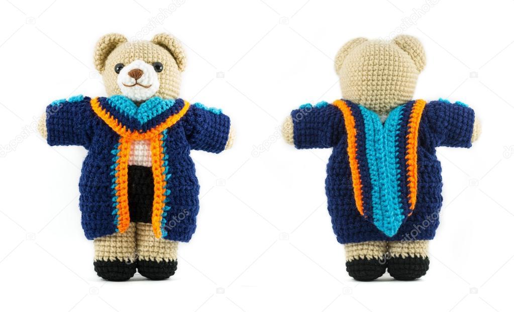 Handmade crochet teddy bear doll with graduation gown on white b